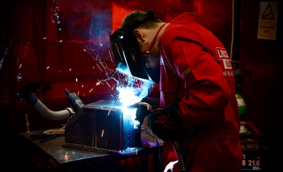 Young person competing in Welding competition