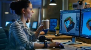 Photo of animator looking at computer screen with animations