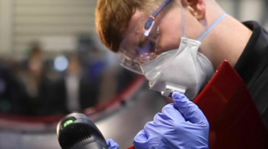 Young person competing in Automotive Body Repair competition