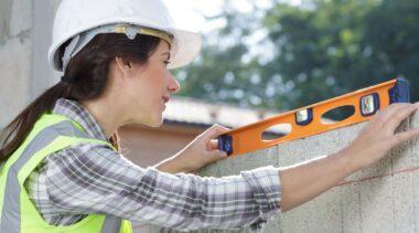 Photo of bricklayer checking bricks are level