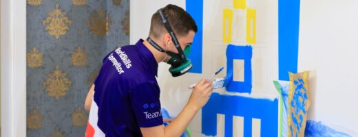 Photo of Callum competing internationally in the Painting and Decorating Competition