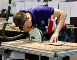 Photo of Christopher competing internationally in the Joinery competition