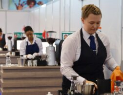 Photo of Collette competing internationally in Restaurant Service Competition
