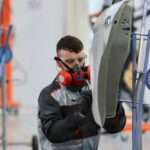 Photo of Conor competing internationally in the Car Painting competition