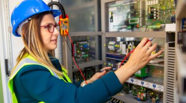 Photo of electrician fixing circuitry
