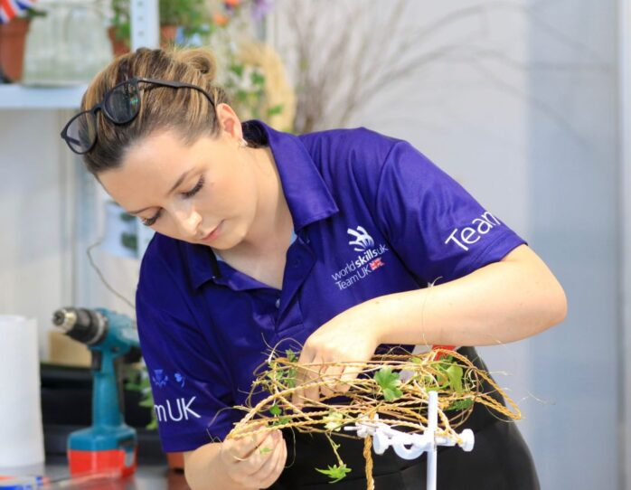 Photo of Elizabeth competing internationally in the Floristry Competition