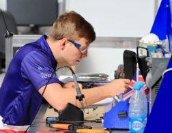 Photo of James competing internationally in the Manufacturing Team Challenge
