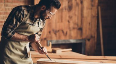 Photo of joiner chiseling a plank of wood