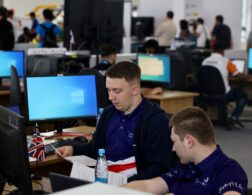 Photo of Kyle and Adrian competing internationally in the Cyber Security competition