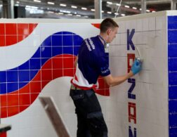 Photo of Mark competing internationally in the wall and floor tiling competition