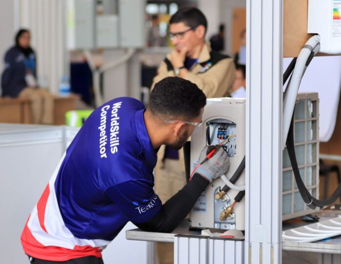 Photo of Orlando competing internationally in the refrigeration and air conditioning competition
