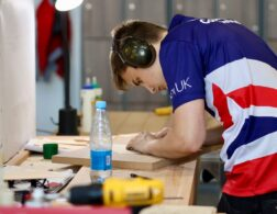 Photo of Owen competing internationally in the cabinet making competition