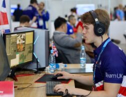 Photo of Patrick competing internationally in the 3D digital game art competition
