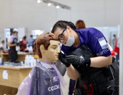 Photo of Phoebe competing internationally in the Hairdressing competition