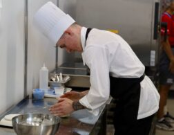 Photo of Sam competing internationally in cooking competition