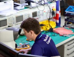 Photo of Thomas competing internationally in Electronics Competition