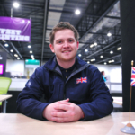 Jon Cleave sitting at desk at WorldSkills London 2011