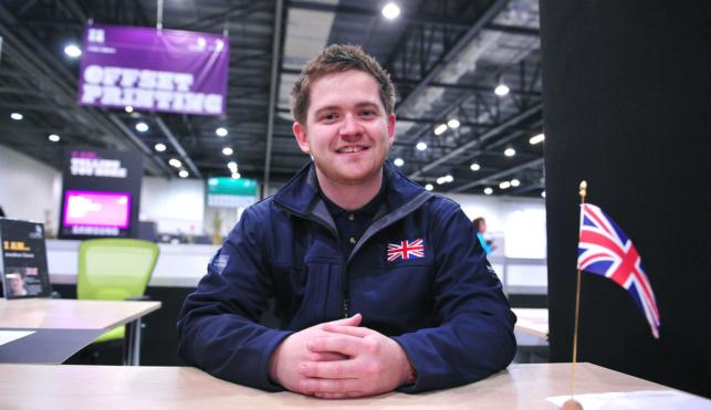 Jon Cleave sitting at desk at WorldSkills London 2011