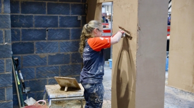 Female plasterer during competition