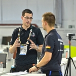 Mark speaking to German competitor