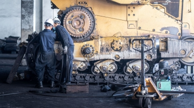 Photo of Heavy machinery maintenance and repair, Mechanic man assembly track link of the bulldozer in coal power plant